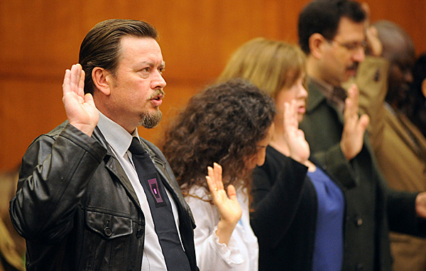 Barry Napier (left), who came to Maine from the United Kingdom and now lives in Passadumkeag, was one of 17 people who were sworn in as new citizens at the U.S. District Court in Bangor Friday morning, April 2, 2010.  The 17 new citizens, who came from 14 different countries, came from as far as Kittery for the ceremony. BANGOR DAILY NEWS PHOTO BY GABOR DEGRE