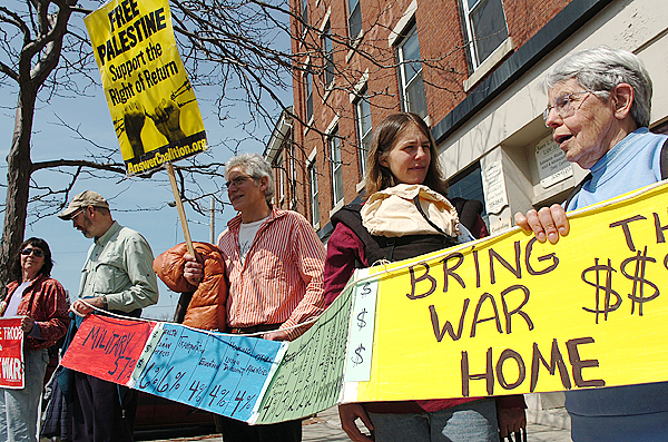 Members of the Waldo County Peace & Justice group including (from left) Meredith Briskin, Andrew Watkins, Jim Merkel, Susan Cutting and Miriam Watkins stand on the corners of Main and High Streets for an hour on Sunday afternoon, April 4, 2010, as many of them have done for nearly 10 years, to discourage the U.S.-led wars in the Middle East and military spending. BANGOR DAILY NEWS PHOTO BY BRIDGET BROWN
