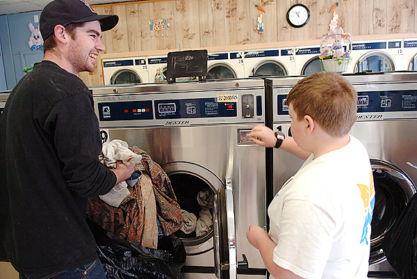 &quotThank you so much,&quot said Zach Block of Monroe as Eli Cushman, 13, of Northport helped him with six months worth of laundry on Sunday, April 4, 2010 as part of &quotTake It To The Streets&quot, a weekend of community service projects through Little River church in Belfast  where Cushman is a member. In lieu of a Sunday Easter service, about 100 church members volunteered to wash cars and visit residents in a nursing home. BANGOR DAILY NEWS PHOTO BY BIDGET BROWN