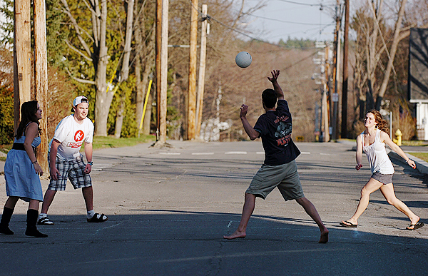 University of Maine students (from left) Kristie O'Brien, T. J. Hill, Jesse Kaye-Schiess and Leah MacNichol play a game of four-square on Pine Street in Orono on Saturday, April 3, 2010. &quotIt's a nice change,&quot said MacNichol of the weather which topped out in the high-70s both days of the weekend. BANGOR DAILY NEWS PHOTO BY BRIDGET BROWN