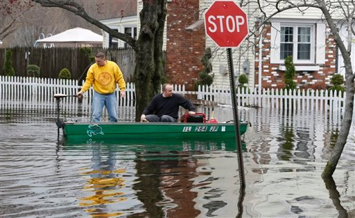 FILE - In this March 31, 2010 file photo, Roger St. Onge, of Narragansett, R.I., left, and Phil Pendergast deliver a generator to the Pendergast house in the East Natick section of Warwick, R.I. ; The Northeast is seeing more frequent &quotextreme precipitation events&quot in line with global warming predictions, a study released Monday, April 5, 2010 shows, including storms like the recent fierce rains whose floodwaters swallowed neighborhoods and businesses across New England. (AP Photo/Joe Giblin, File)