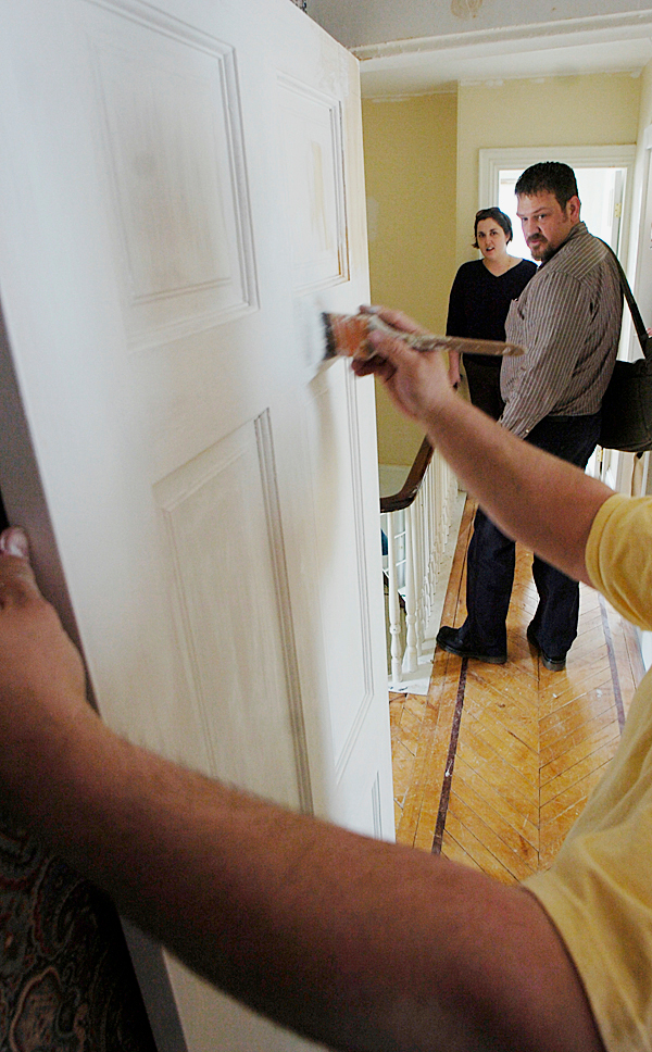 City of Bangor Housing Rehabilitation Coordinator Jeff Wallace, right, and Kaleena Harrington, Assistant Community  Development  Director for the City of Bangor, left, watch a painter as he primes doors at 13 Sanford Street during a tour on Monday, April 5, 2010 to show off the renovations being done. The City of Bangor has received a grant of $1,084,873 from the Neighborhood Stabilization Program. The money is being used to purchase abondoned or foreclosed homes then renovate then and sell them. BANGOR DAILY NEWS PHOTO BY KEVIN BENNETT