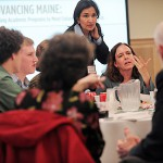 Sarah Hardy (cq) (seated), Associate Professor of Mathamatics at the University of Maine-Farmington and Sheena Bunnell (standing) , Professor of Business/ Economics at UM-F and the Director of the Maine Health Research Institute  joined colleagues in a roundtable discussion--part of Tuesday's academic summit at Wells Conference Center at the University of Maine in Orono. The summit drew campus community from the University of Maine System to assess Maine's future workforce needs and academic program development. BANGOR DAILY NEWS PHOTO BY JOHN CLARKE RUSS