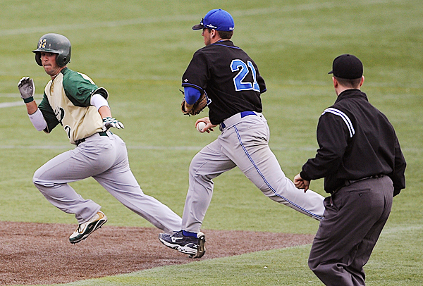 Husson University's Tom Crews of Bangor escapes Colby's Ryan Conlon in a rundown to second base during the second inning Tuesday's game at Husson's Winkin Complex. Seconds later, he stole third base and scored on a hit from Corey Cushing of Brewer. BANGOR DAILY NEWS PHOTO BY JOHN CLARKE RUSS