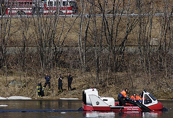 Members of Bangor-Brewer Fire Rescue used their hovercraft, the Bon Ton IV, to rerieve a wayward floating boom which  snagged about a third of a mile upstream from the Waterworks in Bangor. Dozens of passersby on both sides of the Penobscot River stopped to look late Sunday morning after rumors floated that a &quotwhale&quot had been spotted. BANGOR DAILY NEWS FILE PHOTO BY JOHN CLARKE RUSS