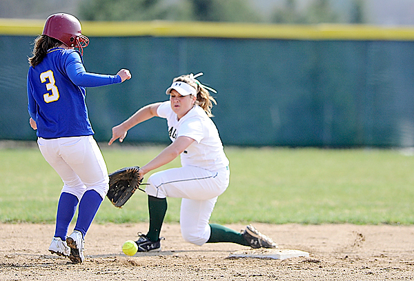 U Maine-Presque Isle's Brittany Humphrey (#3) made it safely back to second base just before a thrown ball bounced over Husson University's Cassie Berry in the third inning of their game at Husson University Wednesday afternoon, April 7. 2010. BANGOR DAILY NEWS PHOTO BY JOHN CLARKE RUSS