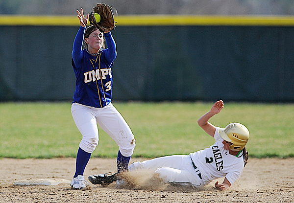 Husson University's Courtney Hill slid her foot between the legs U Maine-Presque Isle's Brittany Humphrey (#3) to reach second base safely during the sixth inning of their game at Husson University Wednesday afternoon, April 7. 2010. BANGOR DAILY NEWS PHOTO BY JOHN CLARKE RUSS