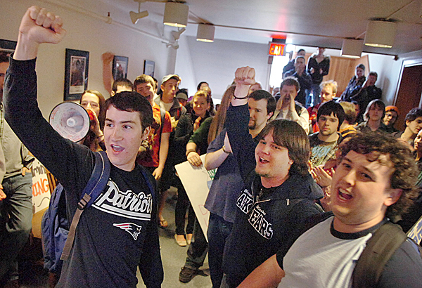 University of Maine students including (from left) sophomore Michael Arell, senior Jeff Fairfield and junior Dan Dixon sing the Maine &quotStein Song&quot outside of President Robert Kennedy's office in Alumni Hall on campus in Orono Wednesday, April 7, 2010 following a protest to proposed reductions of academic programs at the university. BANGOR DAILY NEWS PHOTO BY BRIDGET BROWN