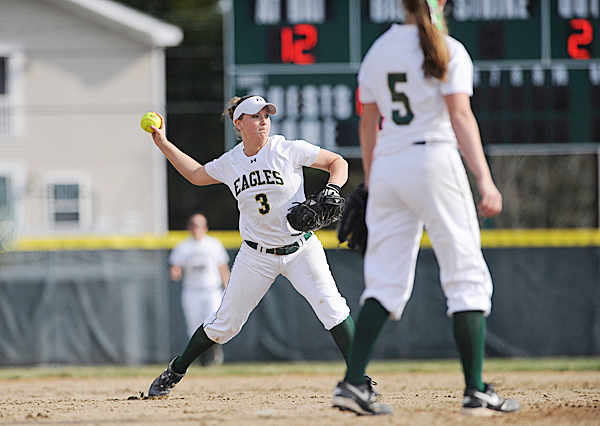 Grabbing a ground ball, Husson University's Aimee Mortensen throws to firstbase to out UMPI's Lainey Herring during the sixth inning of their game at Husson University Wednesday afternoon, April 7. 2010. BANGOR DAILY NEWS PHOTO BY JOHN CLARKE RUSS