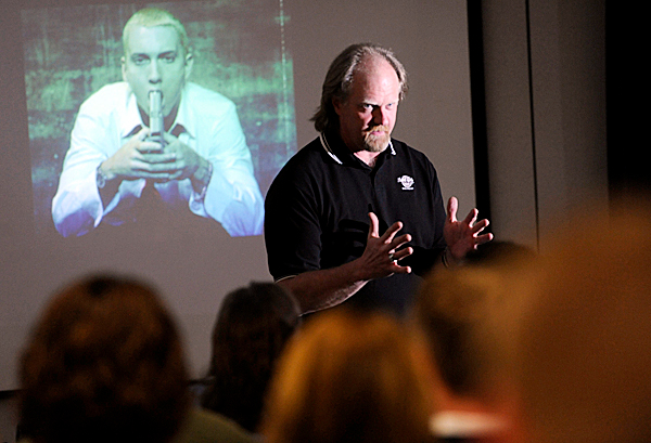 Dan Frazell of Orrington, a retired Bangor Police officer, gave a presentation about &quot How the Media Is Killing Our Children&quot at Center Drive School in Orrington Wednesday evening, April 7, 2010. In the picture shown on projection screen behind him is a photo of American rapper, record producer, songwriter and actor known by the stage name Eminem (actual name Marshall Bruce Mathers III) weilding drug paraphenalia. He show this and other  photos to demonstrate the negative effect certain media can  can have on youths. BANGOR DAILY NEWS PHOTO BY JOHN CLARKE RUSS