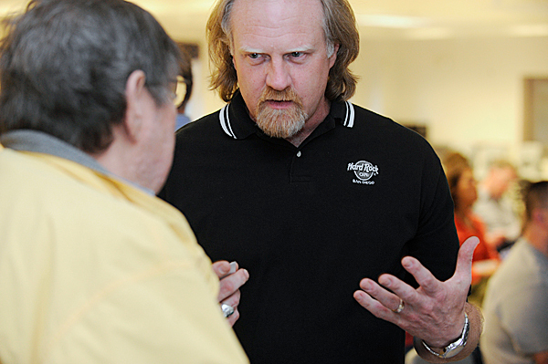 Dan Frazell (facing camera) of Orrington, a retired Bangor Police officer chats with attendee Nick Bearce of Bangor before giving a presentation about &quot How the Media Is Killing Our Children&quot at Center Drive School in Orrington Wednesday evening, April 7, 2010. BANGOR DAILY NEWS PHOTO BY JOHN CLARKE RUSS