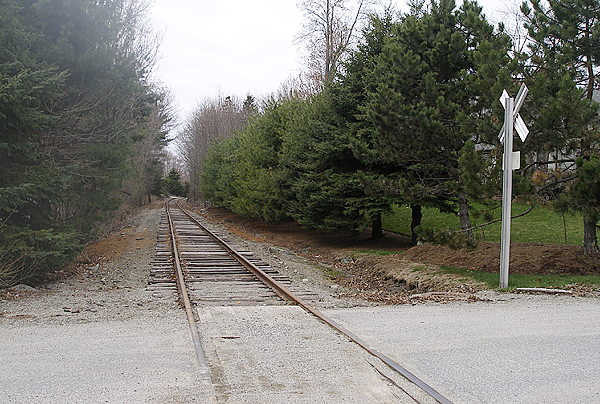 The Maine Department of Transportation plans to construct a 1.3-mile bicycle and pedestrian trial along the old Calais Branch rail line in Ellsworth beginning here where the tracks cross Birch Avenue. Work on the trail, which will be built on the north (right) side of the tracks, is expected to begin this fall. (Bangor Daily News photo by Rich Hewitt)