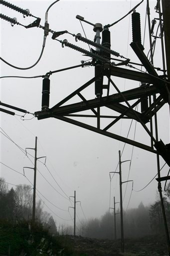 High-voltage transmission lines are seen  in Duxbury, Vt.,Thursday, April 8, 2010. Environmental groups on both sides of the U.S.-Canadian border are teaming up to study the impacts of the provincial utility Hydro-Quebec's big hydropower developments. They also want to look at whether big new power imports from Canada might discourage the development of renewable energy in New England and New York.  (AP Photo/Toby Talbot)