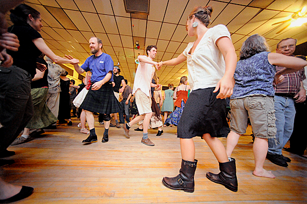 Particpants move to the eclectic beats of the Whitefield-based Henry Road Bandits during Belfast Flying Shoes contradance at American Legion Post 43 Friday night, April 2, 2010. BANGOR DAILY NEWS PHOTO BY JOHN CLARKE RUSS