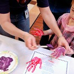 Penquis Division Manager Mary Lynn Hersey (left) helps Tegan Townsend, 5, of Bangor make handprints at the Children's Fair at the Airport Mall in Bangor on Sunday afternoon, April 11, 2010. The fair was one in a series of weeklong events that are part of Week of the Young Child, which is designed to recognize the needs of young children and inform the community of various programs and services available for them and their families.  BANGOR DAILY NEWS PHOTO BY BRIDGET BROWN