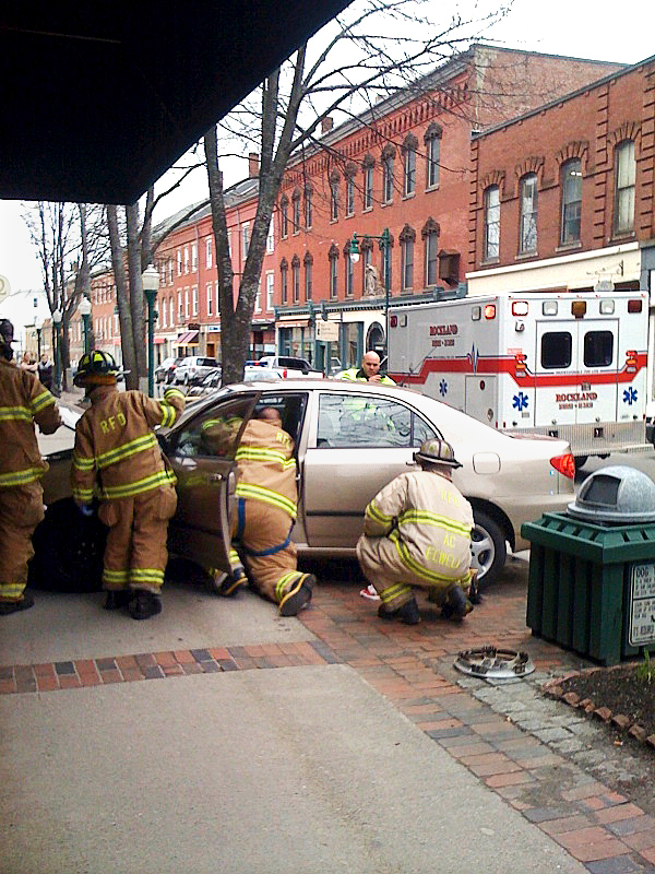 Emergency workers attend to the driver of a car that crashed into The Grasshopper Shop on Main Street in Rockland around noontime Saturday. Shop employees called 911 and police and ambulance arrived on the scene soon afterward. The driver of the car, Mary Quinn, 85, of Vinalhaven was transported to Eastern Maine Medical Center in Bangor, according to Sgt. Ken Smith of the Rockland Police Department. No passersby were hurt in the accident.  BANGOR DAILY NEWS PHOTO BY MARIO MORETTO