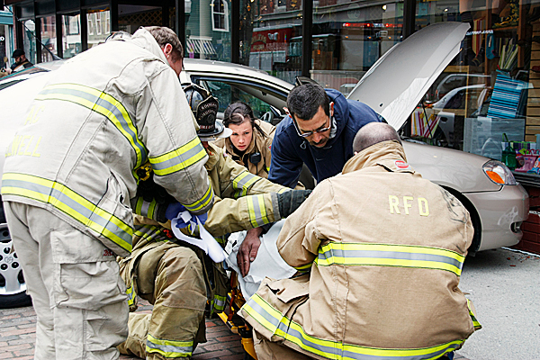 Emergency workers attend to the driver of a car that crashed into The Grasshopper Shop on Main Street in Rockland around noontime Saturday. Emergency responders are (from left) Assistant Chief Ken Elwell, Lieutenant Rich Johnson, Firefighter Katy Vanorse, Firefighter Arthur Hutchinson, and Paramedic Mike Percy.  PHOTO COURTESY OF ROCKLAND FIRE DEPT / ALAN ATHERN