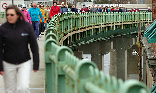 Community members cross the Joshua Chamberlain Bridge from Brewer into Bangor on Saturday morning, April 10, 2010 as part of the 15th annual Hike for the Homeless. This year's goal was to raise $50,000 according to the Bangor Area Homeless Shelter director Dennis Marble. BANGOR DAILY NEWS PHOTO BY BRIDGET BROWN