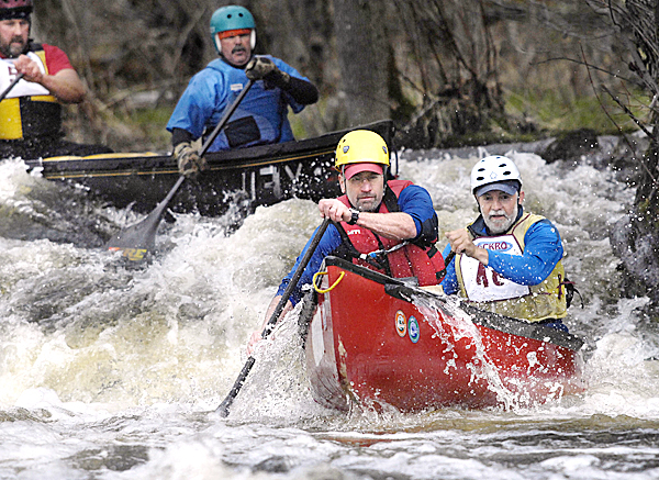 The Dedham duo of Bob Martin and Eric Taylor set their sights under the bridge as they pass over the fall at Emerson MIll Road on the Souadabscook Stream canoe race, Saturday, April 10, 2010. Bangor Daily News/Michael C. York