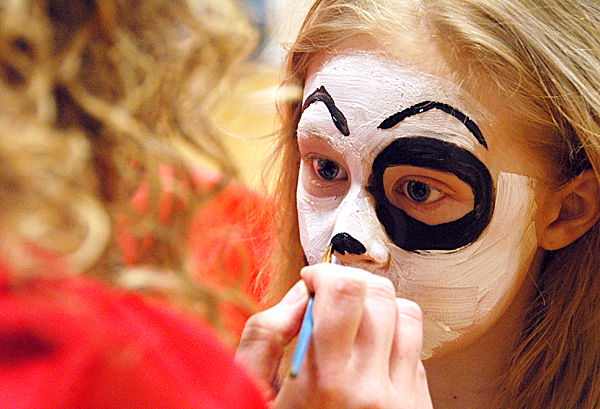 Seven-year-old Kortnie Trott of Lincoln has her face painted like a puppy?s by Michelle Russell, director of the Lincoln KidCare America After-School Mentoring Program, at the annual Lincoln Lakes Region Chamber of Commerce Expo at Mattanawcook Academy of Lincoln on Saturday, April 10, 2010.  BANGOR DAILY NEWS PHOTO BY NICK SAMBIDES JR.
