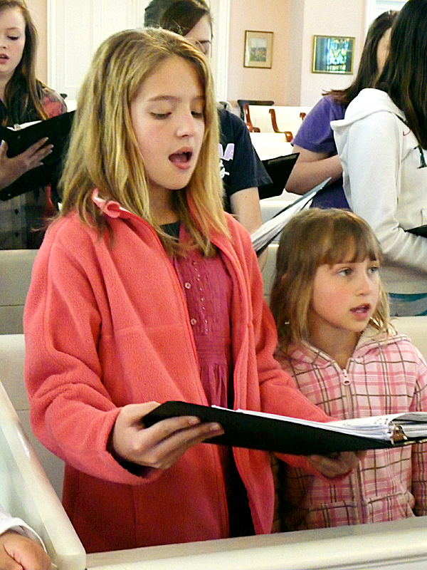 Emily Lobley, 11, and Maia Loeb, 8, both of Marshfield, sing out during a rehearsal Sunday of the Washington County Children's Chorus. The group will be performing a series of concerts this summer, including a performance in Luxembourg in June. The group will be holding a series of fundraisers to gather the $18,000 for the trip. The 49 children range in age from eight to 17 and come from Calais to Steuben.(Bangor Daily News/Sharon Kiley Mack)