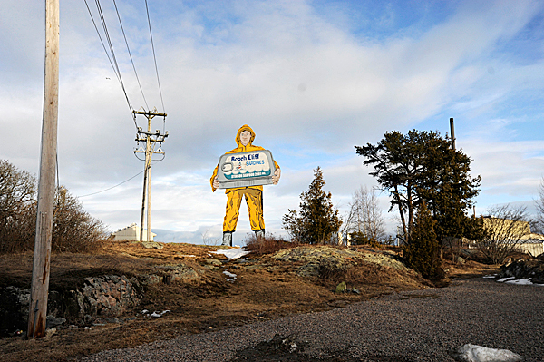 The Beach Cliff Sardine fisherman sign towers over all else in front of the former Stinson Seafood Plant in Prospect Harbor Thursday  February 18, 2010. Bumble Bee Foods, the current plant owner notified employees Wednesday, February 17 that the plant will close in April after being a fixture there for over 100 years.   BANGOR DAILY NEWS FILE PHOTO BY JOHN CLARKE RUSS