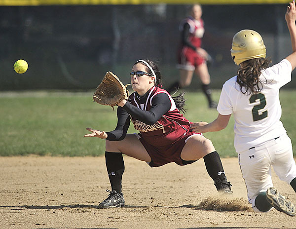 UMF's Samantha Morency, (7), takes the throw from catcher McKell Barnes,(13), in plenty  of time to tag out Husson's Courtney Hill, (2), at second base in the first inning of their game in Bangor, Wednesday, April 14, 2010.