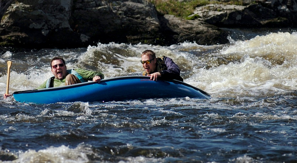 Dave Dube (left) of Glenburn and Kirk Winters of Levant take a tumble Wednesday afternoon, April 14, 2010 while negotiating Six Mile Falls on the Kenduskeag Stream in preparation for Saturday's race, which begins at 8 a.m. Both are pastors at The Rock Church in Bangor and are raising money, along with other church members, for First Step Pregnancy Resource Center through sponsorships for the race. &quotWe got caught, it filled our boat in and we sunk,&quot said Dube after the trial run. &quotPiece of cake,&quot said Winters jokingly. (Bangor Daily News/Bridget Brown)