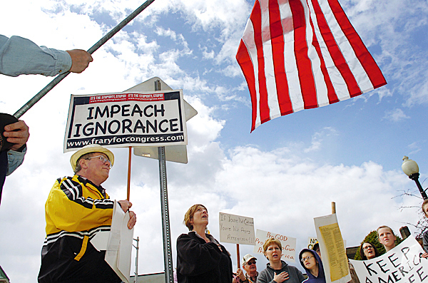 Tea party rally participants including Robert Shaffer of Guilford (left) sing the &quotStar-Spangled Banner&quot in downtown Bangor on Thursday, April 15, 2010 before dumping tea leaves into the Kenduskeag Stream. Similar rallies were replicated in various cities in Maine and throughout the country to coincide with federal income tax day.  BANGOR DAILY NEWS PHOTO BY BRIDGET BROWN