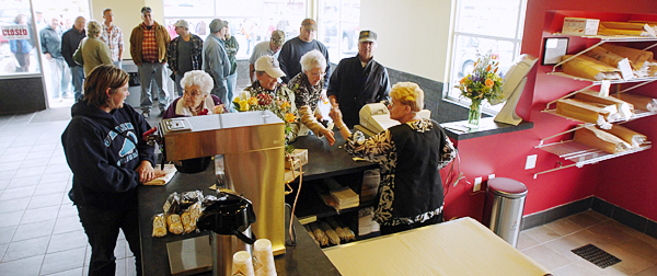 A line runs out the door of the new Coffee Pot Cafe on Broadway in Bangor on Friday, April 16, 2010, as they opened the doors for the first time, offering an old local favorite, the Coffee Pot sandwich. BANGOR DAILY NEWS PHOTO BY KEVIN BENNETT