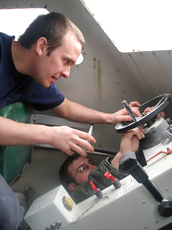 Maine Maritime Academy student Andrew Blackman and University of Maine graduate student Travis Wallace work on the electrical system of an lifeboat they are converting as part of a joint research project at the MMA campus in Castine. They are part of a team of students developing a hybrid vessel using thermoelectric generators to capture waste heat from the boats diesel engine and convert it to electrical power.   BANGOR DAILY NEWS PHOOT BY RICH HEWITT