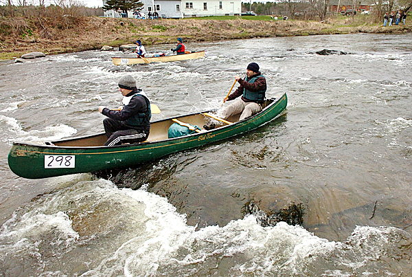 Dimitry and George Gorsky round the first shallow bend at the start of the 44th annual Kenduskeag Stream Canoe Race on Saturday, April 17, 2010. Nearly 900 people participated in the 16.5 mile race. BANGOR DAILY NEWS PHOTO BY BRIDGET BROWN