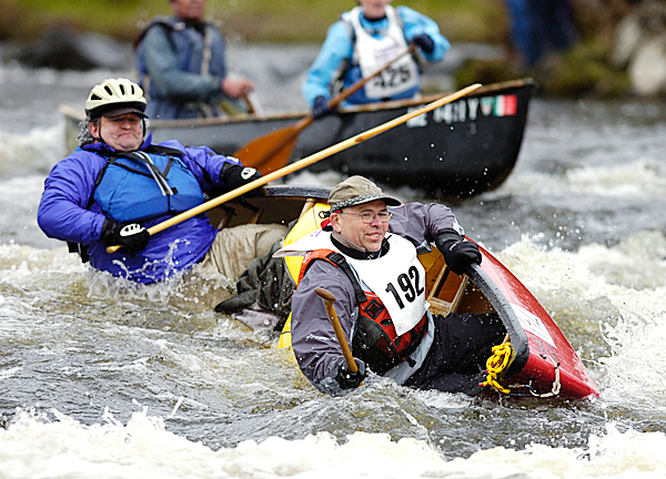 Cliff Raymond, left, of Gorham, Maine and Jim Minner, right, of Summerville, South Carolina dump their canoe at Six Mile Falls in Bangor during the Kenduskeag Stream Canoe Race on Saturday, April 17, 2010.  BANGOR DAILY NEWS PHOTO BY KEVIN BENNETT