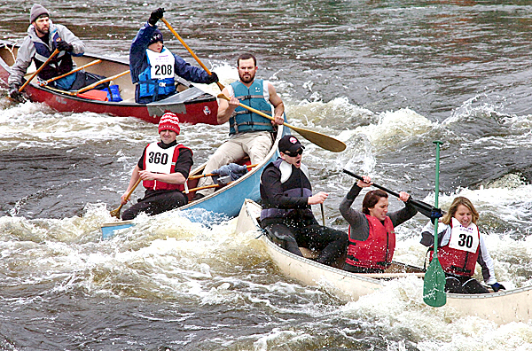 &quotI said uh oh, here we go,&quot said Greg Harvey (upper left) when he saw the congestion at Six Mile Falls while paddling the race with his son Willis, 12, (208) during the 44th annual Kenduskeag Stream Canoe Race on Saturday, April 17, 2010. Also wincing through the rapids are Hogan Haskell and Trevor Herrick (360), both of Bar Harbor, and Trish Wheelden of Glenburn (30) and Audrey Lawrence and Benjamin Smith, both of Veazie. BANGOR DAILY NEWS PHOTO BY BRIDGET BROWN