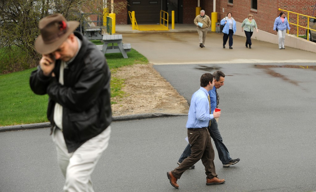 Bangor Daily News emloyees walk out of the newspaper's building on Main Street in Bangor after a bomb threat was called in for the Main Street location.   (Bangor Daily News/Gabor Degre)
