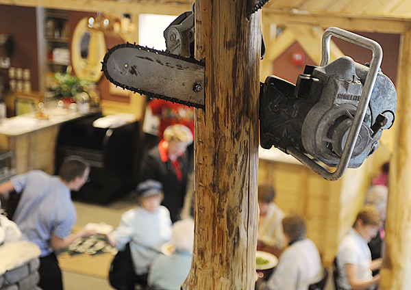 (BANGOR DAILY NEWS PHOTO BY JOHN CLARKE RUSS)  CAPTION  A chainsaw whimsically appears to cut through a support beam in the dining area of the Pelletier Loggers Family Restaurant Bar and Grill. The Millinocket restaurant opened in March of this year and has drawn large crowds, including fans of the &quotAmerican Loggers&quot television show which features members of the Pelletier family. (Bangor Daily News/John Clarke Russ)