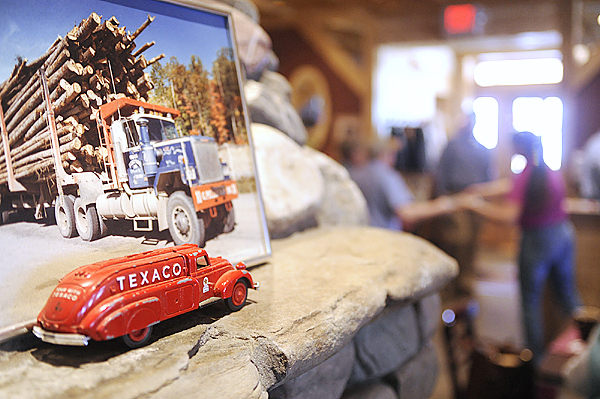 (BANGOR DAILY NEWS PHOTO BY JOHN CLARKE RUSS)  CAPTION  A Pelletier family photo of one otheir trucks as well as other memorabilia  grace a stone mantle inside the Pelletier Loggers Family Restaurant Bar and Grill. The Millinocket restaurant opened in March of this year and has drawn large crowds, including fans of the &quotAmerican Loggers&quot television show which features members of the Pelletier family. (Bangor Daily News/John Clarke Russ)