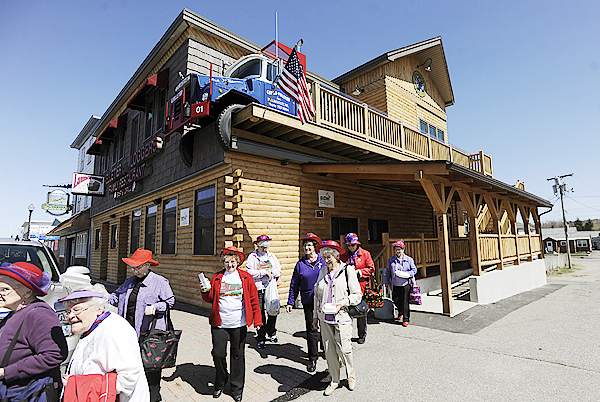 (BANGOR DAILY NEWS PHOTO BY JOHN CLARKE RUSS)  CAPTION  Members of the Klassy Kats With Red Hats (cq) of Lincoln, ME leave Pelletier Loggers Family Restaurant Bar and Grill after having lunch there Tuesday, April 13, 2010. The Millinocket restaurant opened in March of this year and has drawn large crowds, including fans of the &quotAmerican Loggers&quot television show which features members of the Pelletier family. (Bangor Daily News/John Clarke Russ)