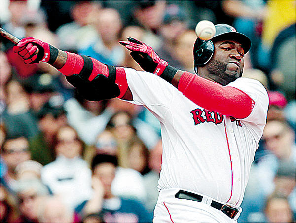 Boston Red Sox's David Ortiz fouls a ball off during the sixth inning of their 8-2 loss to the Tampa Bay Rays in a MLB baseball game at Fenway Park in Boston Monday, April 19, 2010. Ortiz was hitless on the day. (AP Photo/Winslow Townson)