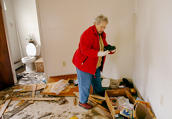 &quotThis is my favorite pair of shoes,&quot said Adrienne Lamarre while looking for salvageable items in her apartment at Fort Kent Housing after the St. John River flooding Sunday. Lamarre, who is staying with a daughter in Eagle Lake, came to look through her belongings for a second day in a row Sunday. &quotI'm taking it a day at a time,&quot she said. BANGOR DAILY NEWS FILE PHOTO BY BRIDGET BROWN