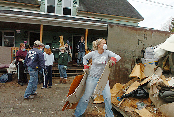FLOOD CLEANUP IN FORT KENT   Fort Kent resident Robin Levasseur (right) and a dozen others help clean up the home of Dean Brundy on Sunday after the Sint John River flooded. Brundy and his trhee children have lived in the home for seven years. BANGOR DAILY NEWS FILE PHOTO BY BRIDGET BROWN