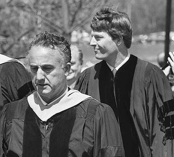 DELMONT MERRILL, president of Husson College (left), and Gov. John R. McKernan lead the Hussson College graduates during the commencement ceremony Saturday. BANGOR DAILY NEWS FILE PHOTO BY MARC BLANCETTE. (taken 5/16/87, ran 5/18/87)