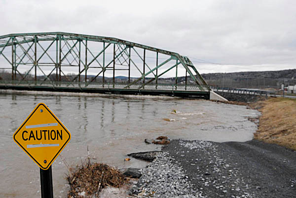The St. John River laps the underside of the International Bridge at the border crossing which was closed in downtown Fort Kent Wednesday  April 30, 2008.   BANGOR DAILY NEWS FILE PHOTO BY JOHN CLARKE RUSS