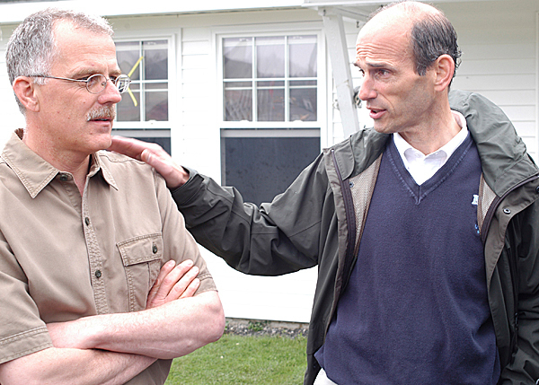 Town Manager Donald Guimond [left] talks with Gov. John Baldacci during a tour of a Fort Kent Housing subdivision Thursday. The housing was devastated by last week's heavy flooding. BANGOR DAILY NEWS FILE PHOTO BY NICK SAMBIDES JR.