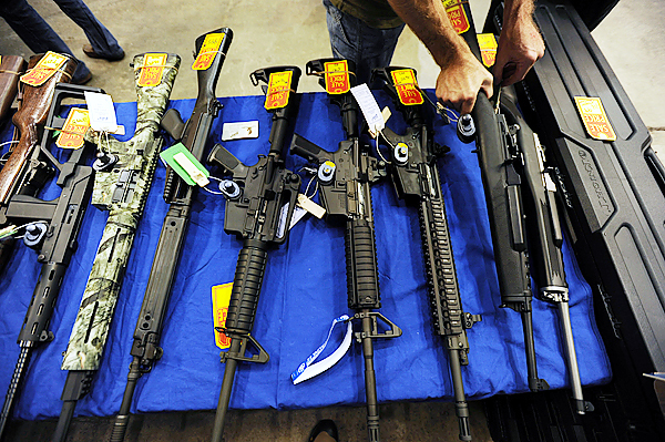 Hunting rifles and home defense weapons are offered for sale at the Bangor Gun Show in September at the Bangor Auditorium.  (BANGOR DAILY NEWS PHOTO BY KEVIN BENNETT)  CAPTION  Hunting rifles along with home defense weapons are offered for sale at the Bangor Gun Show on Saturday, September 12, 2009 at the Bangor Auditorium. (Bangor Daily News/Kevin Bennett)