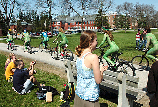 A group of about 30 students at the University of Maine donned green paint and nothing else to celebrate Earth Day, Thursday, April 22, 2010 as they took a 15 minute cycling tour of the campus including the Mall  where they received waves, cheers and a round of applause. BANGOR DAILY NEWS PHOTO BY KEVIN BENNETT