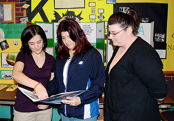 Members of the University of Maine at Fort Kent Student Nurses Organization set up a drug and medication return booth as part of the campus' Earth Day activities on Thursday. A member of the Fort Kent Police Department was on hand to accept any unneeded or expired medication. That service is available yearround at the Fort Kent Police Station. Talking over medication safety from left are student nurses Nicole Marquis, Vickie Lavertu and Michele Soucy. JULIA BAYLY PHOTO