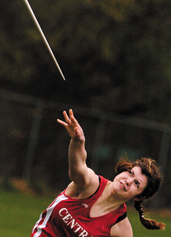 Central High School senior Alexis Lodge hurls her javelin  in a final flight of the girls' javelin event during Friday afternoon's PVC track meet at Cameron Stadium. (Bangor Daily News/ John Clarke Russ)