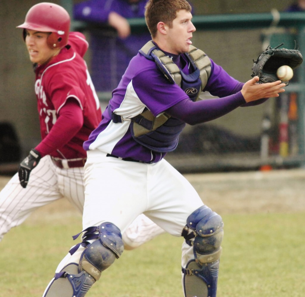 Hampden Academy's catcher, Cody Miller, receives the ball from the outfield as Bangor runner Kyle Savage dashes behind Miller to score at home plate on Friday, April 23, 2010 at Hampden. Bangor won 10-0.  BANGOR DAILY NEWS PHOTO BY KEVIN BENNETT