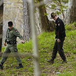 Maine Warden Service members search for Joshua Gilmore behind the Sigma Chi Heritage House on College Avenue in Orono on Saturday after he was reported missing early that morning.  BANGOR DAILY NEWS FILE PHOTO BY KEVIN BENNETT